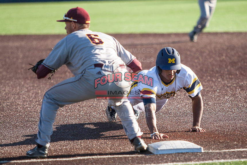 Michigan Wolverines outfielder Johnny Slater (25) dives back to first base against the Central Michigan Chippewas on March 29, 2016 at Ray Fisher Stadium in Ann Arbor, Michigan. Michigan defeated Central Michigan 9-7. (Andrew Woolley/Four Seam Images)