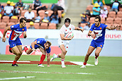 January 27th, Hamilton, New Zealand;  England's Ethan Waddleton evades the French defense during the Day 2 of the HSBC World Rugby Sevens Series 2019, FMG Stadium Waikato,Hamilton, Sunday 27th January 2019.