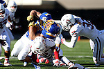 BROOKINGS, SD - NOVEMBER 12:  Kyle Paris #32 from South Dakota State University tis brought down by Marchalo Judge #2 and Jet  Moreland #32 from the University of South Dakota in the first half at the Dana J. Dykhouse Stadium November 12, 2016 in Brookings, South Dakota. (Photo by Dave Eggen/Inertia)