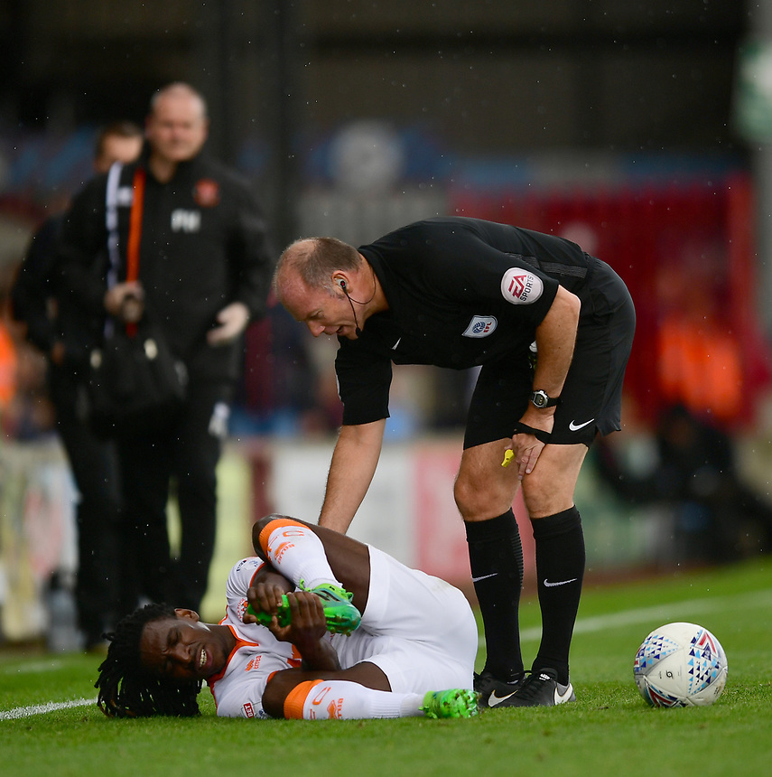 Referee Andy Haines checks on Blackpool's Sessi D'Almeida after he was fouled by Scunthorpe United's Conor Townsend<br /> <br /> Photographer Chris Vaughan/CameraSport<br /> <br /> The EFL Sky Bet League One - Scunthorpe United v Blackpool - Saturday 9th September 2017 - Glanford Park - Scunthorpe<br /> <br /> World Copyright &copy; 2017 CameraSport. All rights reserved. 43 Linden Ave. Countesthorpe. Leicester. England. LE8 5PG - Tel: +44 (0) 116 277 4147 - admin@camerasport.com - www.camerasport.com