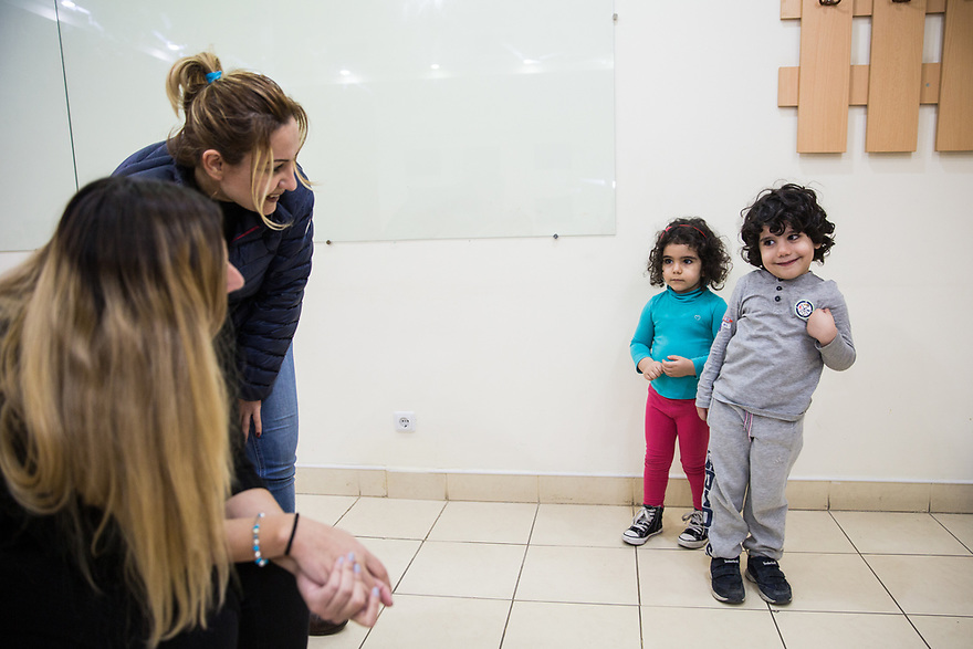 Dalar Baghdo introducing her son, Paul and daughter Patil to Russian language instructor Lisa Manukayn at KASA foundation. UNHCR and KASA run the joint project Vocational Educational Training (VET) for Syrian-Armenian refugees.