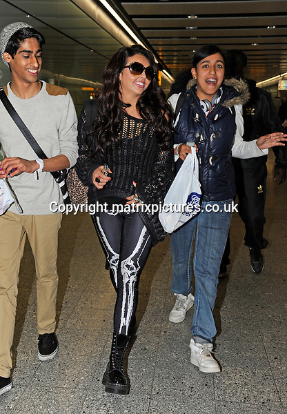 EXCLUSIVE ALL ROUND PICTURE:  MATRIXPICTURES.CO.UK.PLEASE CREDIT ALL USES..WORLD RIGHTS..British four-piece girl-group Little Mix are spotted at London's Heathrow International Airport as they are about to board a flight bound for Sydney, Australia...OCTOBER 26th 2012..REF: STD 124846