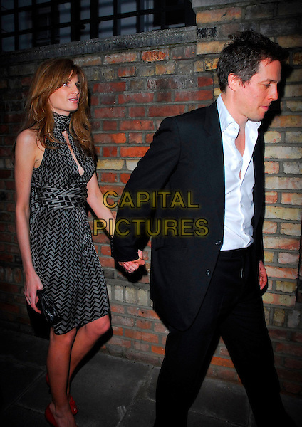 JEMIMA KHAN & HUGH GRANT.Sir David Frost Summer Party, Carlyle Square, London, UK..July 5th, 2006.Ref: CAN.full length black suit grey gray pattern dress couple red shoes profile holding hands.www.capitalpictures.com.sales@capitalpictures.com.©Capital Pictures