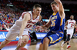 SIOUX FALLS, SD: MARCH 6: Matt Mooney #13 from the University of South Dakota drives against Lane Severyn #25 from South Dakota State University during the Summit League Basketball Championship on March 6, 2017 at the Denny Sanford Premier Center in Sioux Falls, SD. (Photo by Dave Eggen/Inertia)
