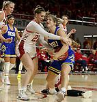 VERMILLION, SD - JANUARY 19: Paiton Burckhard #33 of the South Dakota State Jackrabbits is tied up with Chloe Lamb #22 of the South Dakota Coyotes at the Sanford Coyote Center on January 19, 2020 in Vermillion, South Dakota. (Photo by Dave Eggen/Inertia)