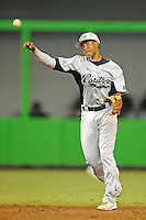 7 March 2012:  FIU shortstop Julius Gaines (2) throws to first base as the Miami Marlins defeated the FIU Golden Panthers, 5-1, at Marlins Park in Miami, Florida.