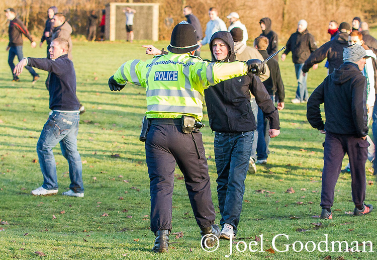 © Joel Goodman - 07973 332324 . 11/12/2010 . Peterborough , UK . Police intervene as EDL supporters and counter-protesters clash in a park in the town . The English Defence League ( EDL ) hold a demonstration in Peterborough . Photo credit : Joel Goodman