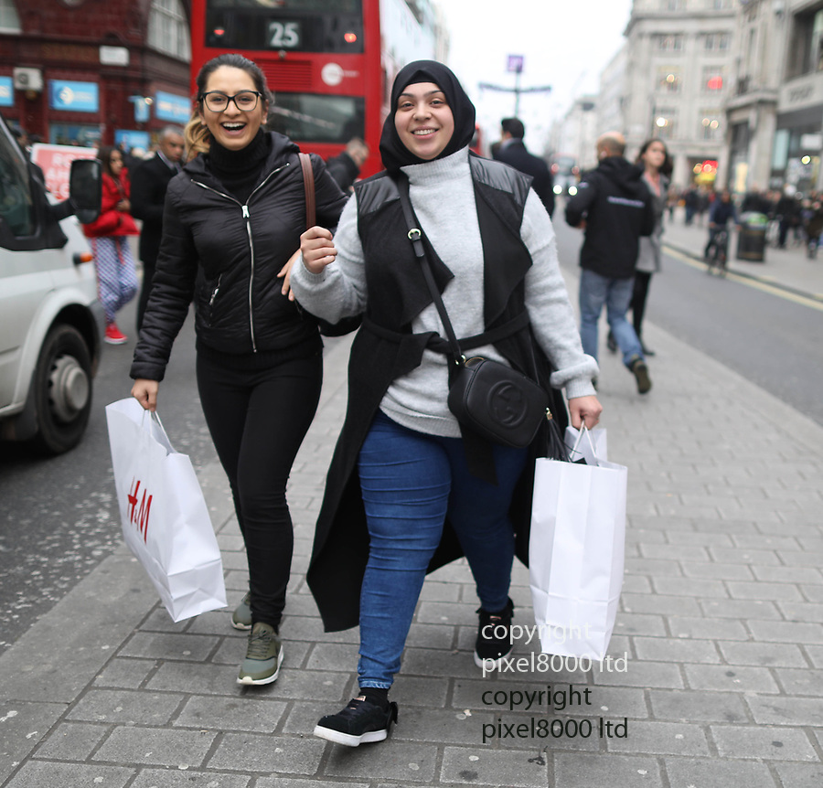 Pic shows: Black Friday sales<br /> <br /> Two young women got up early to nab bargains from H&M<br /> <br /> Shoppers were largely underwhelmed today around Oxford Street but there were large queues outside Apple Shop before it opened.<br /> Apple store did not have official sale but were giving cash back on certain items<br /> <br /> <br /> <br /> <br /> pic by Gavin Rodgers/Pixel8000