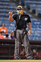 Home plate umpire Chris Gonzalez makes a call during a game between the Omaha Storm Chasers and Nashville Sounds on May 21, 2014 at Herschel Greer Stadium in Nashville, Tennessee.  Nashville defeated Omaha 13-4.  (Mike Janes/Four Seam Images)