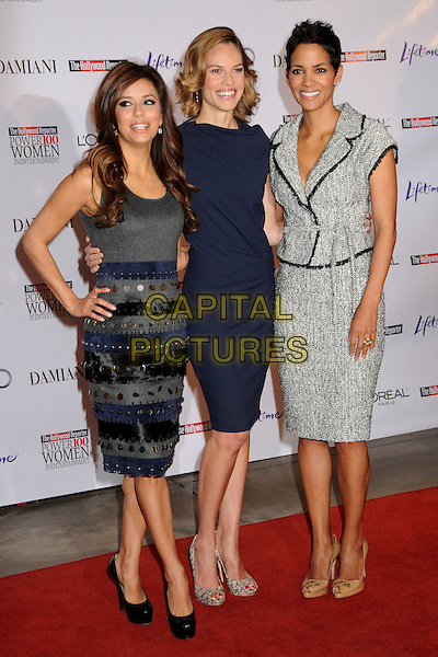 EVA LONGORIA PARKER, HILARY SWANK & HALLE BERRY .Attending the Hollywood Reporter's 18th Annual Women In Entertainment Breakfast held at the Beverly Hills Hotel, Beverly Hills, California, USA, .4th December 2009..full length navy blue dress snakeskin print open toe shoes heels peep hand on hip grey gray black and white wool tweed jacket skirt striped velvet paillettes sequins discs silver platform beige sleeveless .CAP/ADM/BP.©Byron Purvis/Admedia/Capital Pictures