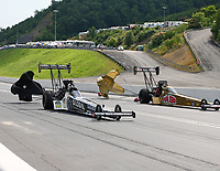 Jun 18, 2017; Bristol, TN, USA; NHRA top fuel driver Shawn Langdon (near) alongside Leah Pritchett during the Thunder Valley Nationals at Bristol Dragway. Mandatory Credit: Mark J. Rebilas-USA TODAY Sports