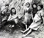 Korean comfort women who survived and were protected in Lameng, Yunnan. The man on the left is a Chinese soldier.  (Photo by Kingendai/AFLO)