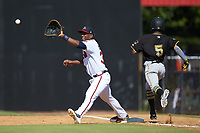 Nicholas Vizcaino (36) of the Danville Braves stretches for a throw as Victor Ngoepe (5) of the Bristol Pirates hustles towards first base at American Legion Post 325 Field on July 1, 2018 in Danville, Virginia. The Braves defeated the Pirates 3-2 in 10 innings. (Brian Westerholt/Four Seam Images)