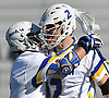 Alex Moeser #2 of Hofstra University, right, gets congratulated by teammate Jimmy Yanes #8 after scoring an unassisted goal in the second quarter of an NCAA Division I men's lacrosse game against visiting Monmouth at Shuart Stadium in Hempstead, NY on Saturday, Feb. 18, 2017. Hofstra won 11-9.