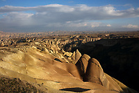 Eroded landscape of Goreme National Park, between Goreme and Uchisar, in Nevsehir province, Cappadocia, Central Anatolia, Turkey. The rock formations here were made by erosion of the volcanic tuff created by ash from volcanic eruptions millions of years ago. The Goreme Valley also contains cave dwellings, underground towns and churches, carved out of the rock in the Byzantine period. This area forms part of the Goreme National Park and the Rock Sites of Cappadocia UNESCO World Heritage Site. Picture by Manuel Cohen