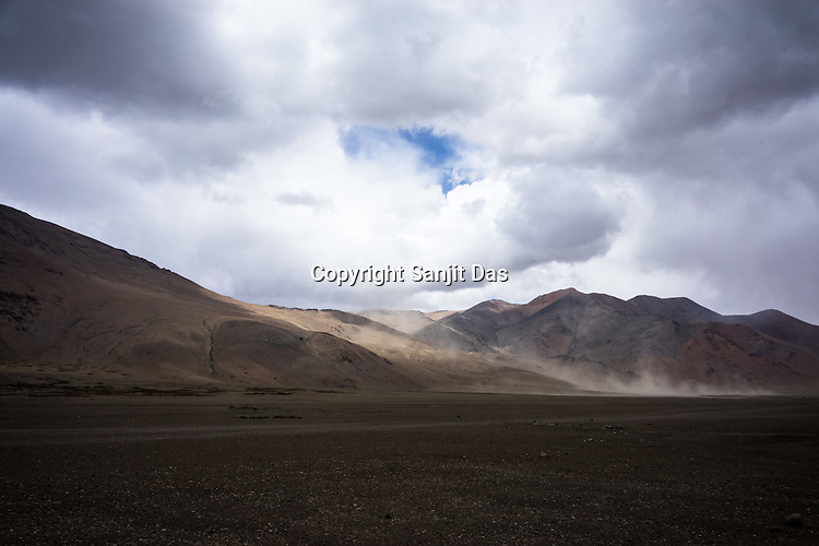 Sand dust flies in the distance on the Pang valley along the Leh Manali highway