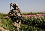 Under enemy fire, Lieutenant Dan Rix of the 82nd Airborne's, 1/508 PIR, Alpha Company, Third Platoon sprints to a new position near Sangin, Helman province, Afghanistan on Wednesday, April 11, 2007.