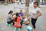 Women Eating At Vendor Stall