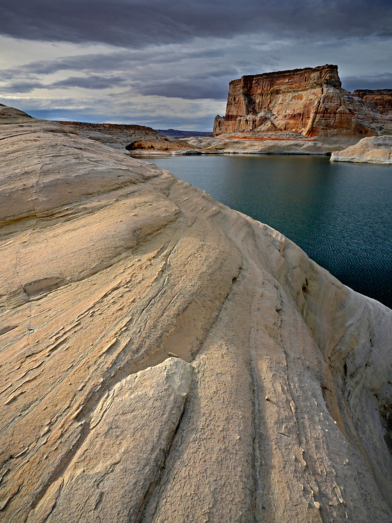 An afternoon storm brews over the sandstone cliffs along Lake Powell in the Glen Canyon National Recreation Area on the Arizona-Utah border.