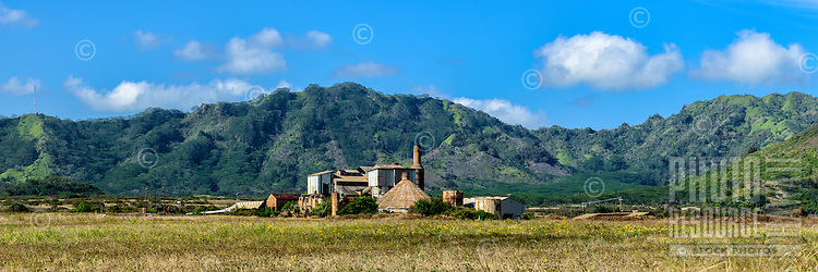 The old Koloa Sugar Mill framed by distant mountains, Kaua'i.