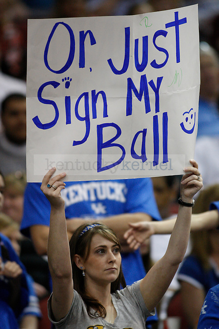 a fan holds a sign during UK's practice at the KFC Yum! Center March 14, 2012. Photo by Brandon Goodwin | Staff
