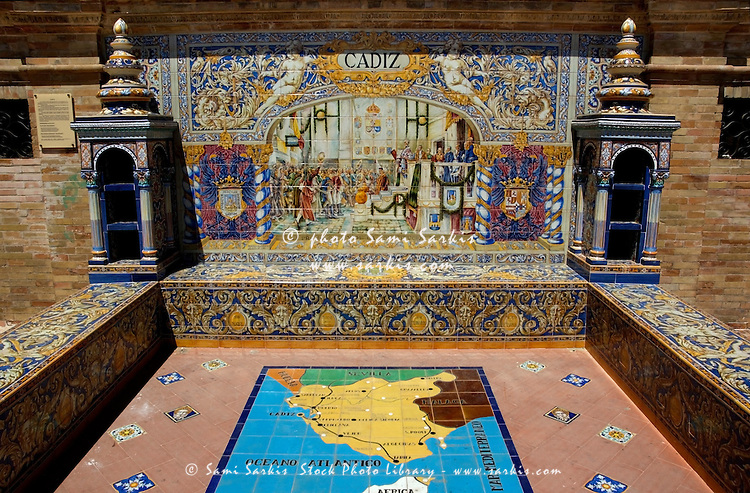 View of the azulejos (mosaic) of the Cadiz province in the Plaza de Espana, Seville, Andalusia, Spain.