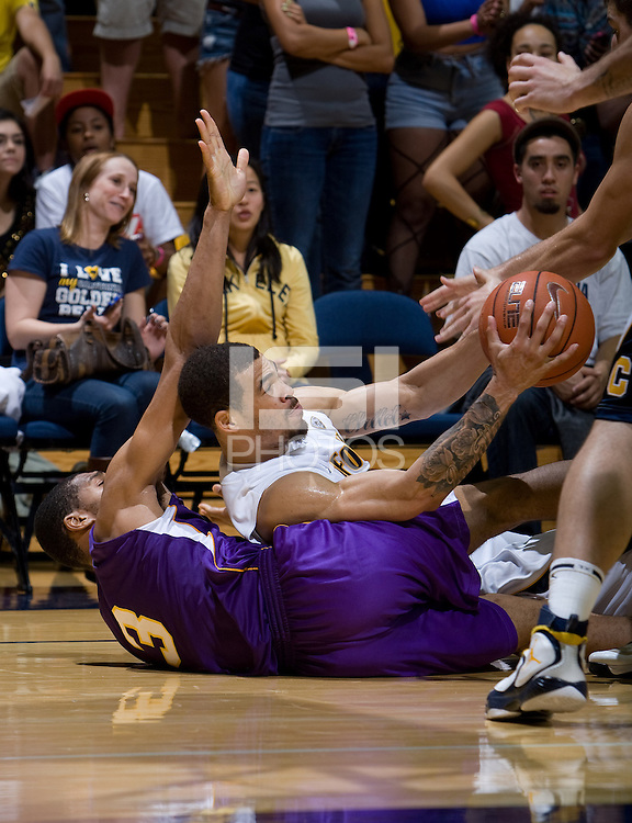 Justin Cobbs of California steals the ball from SFSU during the game at Haas Paviliion in Berkeley, California on November 6th, 2012.  California defeated San Francisco State, 89-80.