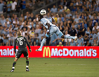 Kei Kamara (23) of Sporting Kansas City heads the ball over Osvaldo Alonso (6) of the Seattle Sounders during the game at Livestrong Sporting Park in Kansas City, Kansas.   Sporting Kansas City won the Lamar Hunt U.S. Open Cup on penalty kicks after tying the Seattle Sounders in overtime.