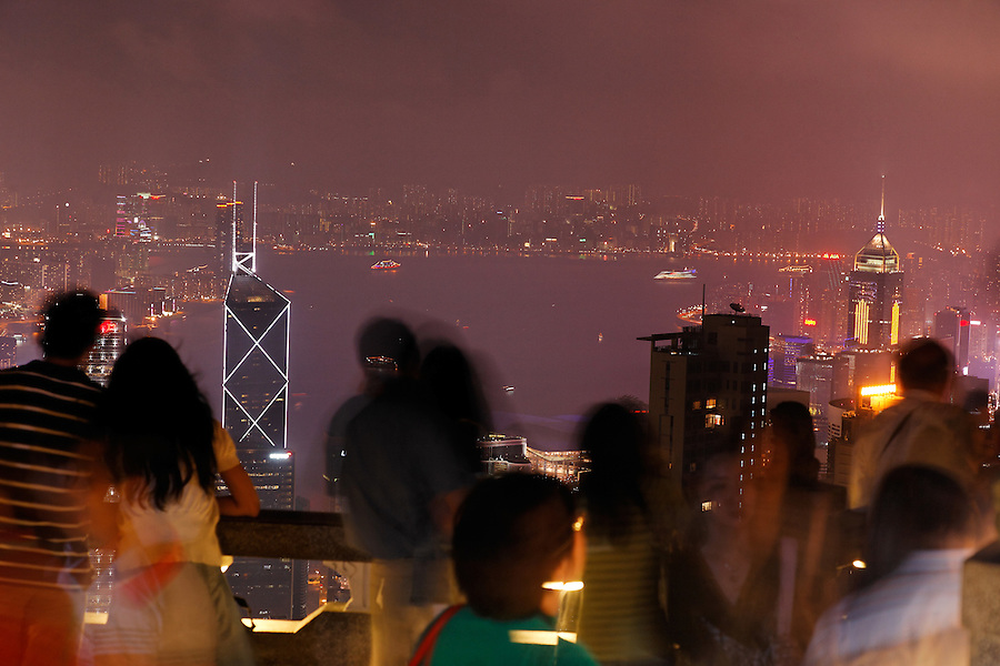 Tourists taking in view of downtown Hong Kong from Victoria Peak at night, Hong Kong SAR, People's Republic of China, Asia