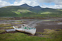 Abandoned boat at the edge of Loch Scridain, Isle of Mull, Scotland, UK. June.