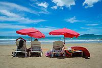 tourists relaxing on beach, Tamarindo beach Costa Rica, Pacific Ocean