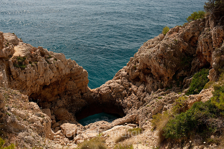 Holes in the rocks of Moraig Beach surroundings. Benitachell village, Alicante province, Costa Blanca, Spain, Europe.