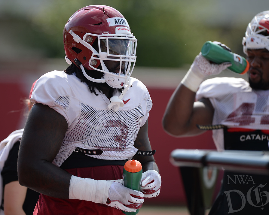 NWA Democrat-Gazette/ANDY SHUPE<br /> Arkansas defensive lineman McTelvin Agim takes part in a drill Tuesday, Aug. 13, 2019, during practice at the university practice facility in Fayetteville. Visit nwadg.com/photos to see photographs from the practice.