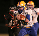 HOWARD, SD - NOVEMBER 8:  Grant Johnson #18 from Alcester Hudson prints downfield past Tanner Henkel #12 from Howard in the first half of their Class 9A Semifinal game Saturday night in Howard. (Photo by Dave Eggen/Inertia)