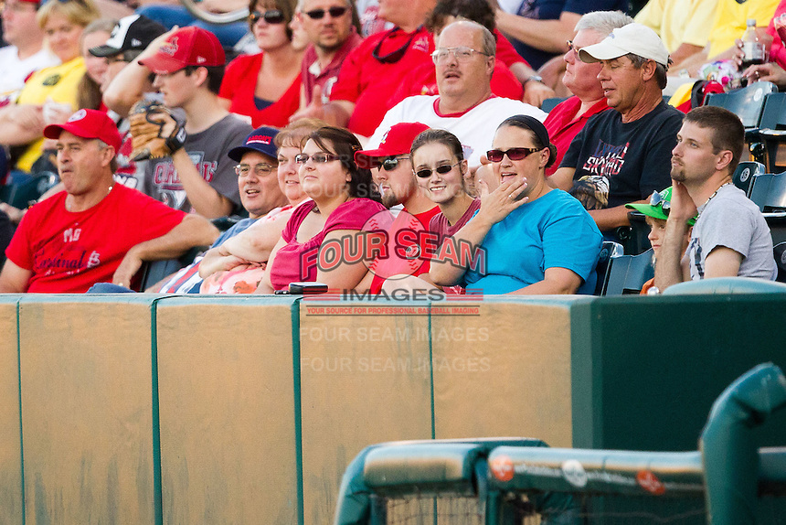 Fans sit in the late evening sunlight during a game between the Northwest Arkansas Naturals and the Springfield Cardinals at Hammons Field on June 14, 2012 in Springfield, Missouri. (David Welker/Four Seam Images)