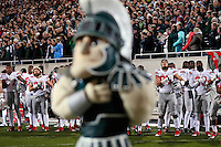 Ohio State players listen to the National Anthem prior to the Buckeyes' 49-37 win over Michigan State in the NCAA football game at Spartan Stadium in East Lansing, Michigan on Nov. 8, 2014. (Adam Cairns / The Columbus Dispatch)