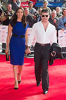 Lauren Silverman and Simon Cowell arriving for the Princes Trust Awards, at the Odeon Leicester Square, London. 10/03/2015 Picture by: Dave Norton / Featureflash