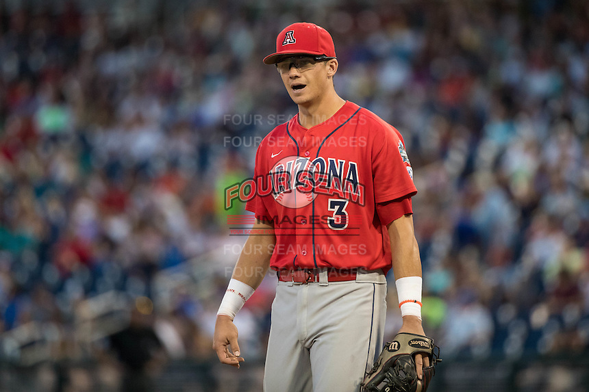 Bobby Dalbec #3 of the Arizona Wildcats looks on during a College World Series Finals game between the Coastal Carolina Chanticleers and Arizona Wildcats at TD Ameritrade Park on June 27, 2016 in Omaha, Nebraska. (Brace Hemmelgarn/Four Seam Images)