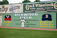 Birmingham Barons coach Jamie Dismuke (52) looks at the outfield signs before the 20th Annual Rickwood Classic Game against the Jacksonville Suns on May 27, 2015 at Rickwood Field in Birmingham, Alabama.  Jacksonville defeated Birmingham by the score of 8-2 at the countries oldest ballpark, Rickwood opened in 1910 and has been most notably the home of the Birmingham Barons of the Southern League and Birmingham Black Barons of the Negro League.  (Mike Janes/Four Seam Images)