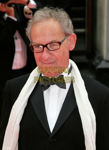 SIMON SCHAMA.Red Carpet Arrivals at The British Academy Television Awards (BAFTA's) Sponsored by Pioneer, held at the London Palladium, London, England, May 20th 2007. .portrait headshot glasses black suit tuxedo bow tie white cream scarf.CAP/AH.©Adam Houghton/Capital Pictures.