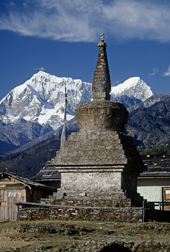 Stupa & prayer flag pole near Tragsindho Pass with Numbur (L) & Khatang peaks behind - SOLU DISTRICT, NEPAL