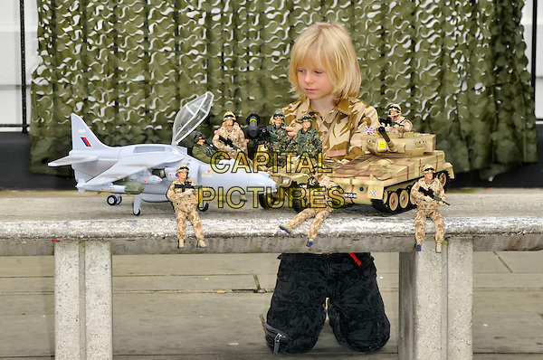 H.M. ARMED FORCES TANK & VECTOR.The 12 'Dream Toys' of predicted top selling toys for Christmas on  in London, England. The Toy Retailers Association (TRA) have announced their annual prediction of Christmas best-sellers priced under 50 GBP which are likely to sell well in the run up to Christmas. .October 28th, 2009 .kid child camouflage army figurines models bench kneeling plane fighter tank pilots jet.CAP/PL.©Phil Loftus/Capital Pictures.