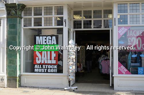 Mega Sale sign in shop window.