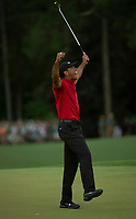 Tiger Woods (USA) celebrates after sinking his putt to win the 2019 Masters , Augusta National, Augusta, Georgia, USA. 14/04/2019.<br /> Picture Fran Caffrey / Golffile.ie<br /> <br /> All photo usage must carry mandatory copyright credit (© Golffile | Fran Caffrey)