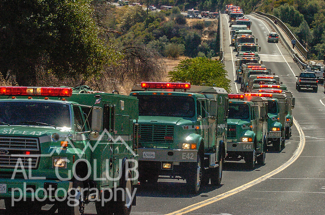 September 20, 2004 Angels Camp, California --Tuolumne Fire –- CDF Engine 4474 with fallen firefighter Eva Marie Schicke's casket crosses Parrots Ferry Bridge on way to her memorial service held at the Calaveras County Fairgrounds.  The Tuolumne Fire was a small very fast-moving fire that started around noon on September 12, 2004 near Lumsden Bridge at the bottom of the Tuolumne River.  The fire moved rapidly up the 80-plus-degree slope catching Cal Fire Helitack firefighters, tragically killing firefighter Eva Marie Schicke and injuring five others.injuring five others.