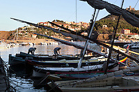 Traditional Catalan fishing sailing boats in the harbour, Collioure, France. Picasso, Matisse, Derain, Dufy, Chagall, Marquet, and many others immortalized the small Catalan harbour in their works. Picture by Manuel Cohen.