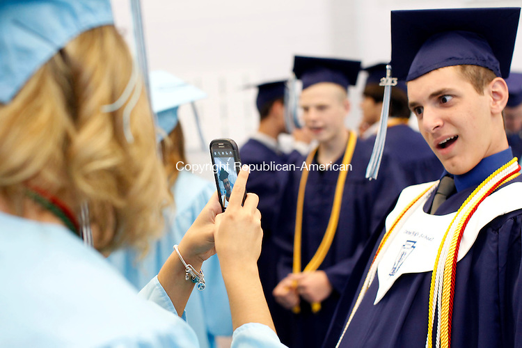 Oxford, CT- 21 June 2013-062113CM01-  James Kostka makes a face as he has his picture taken before the start of commencement exercises at Oxford High School Friday night.  Christopher Massa Republican-American