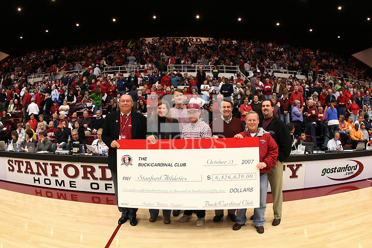 22 December 2007: Members of the Buck Cardinal Club present a check during Stanford's 73-69 win over Tennessee at Maples Pavilion in Stanford, CA.