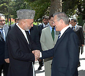 Kabul, Afghanistan - July 11, 2006 -- President Hamid Karzai of Afghanistan bids farewell to United States Secretary of Defense Donald H. Rumsfeld at the conclusion of his visit to the presidential compound in Kabul, Afghanistan, on July 11, 2006.  Rumsfeld is in Kabul to meet with Karzai and other senior leaders to discuss regional defense issues of mutual interest.  <br /> Mandatory Credit: Gary Hilliard/U.S. Army via CNP