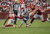New England Patriots running back James White (28) carries the ball in the fourth quarter against the Washington Redskins at FedEx Field in Landover, Maryland on Sunday, October 6, 2019.  Defending on the play are Washington Redskins cornerback Josh Norman (24) and linebacker Cole Holcomb (55). The Patriots won the game 33 - 7.<br /> Credit: Ron Sachs / CNP
